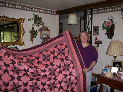 Kim Kelley wins the Rose Quilt